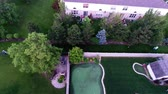 vista : Aerial view of backyard putting green from in air flight above ground