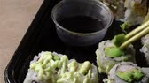 asya mutfağı : Eating sushi in carry out container with chopstick from Japanese restaurant
