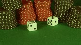 volný čas : Two rolling white dice on casino table - Gambling addiction concept
