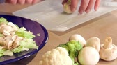 chef kitchen : Man preparing dinner salad cutting lettuce and fresh vegetables with a knife Stock Footage