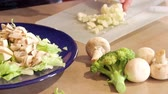 диеты : Preparing dinner salad cutting lettuce and fresh vegetables with a knife