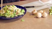 zdrowy styl życia : Preparing dinner salad cutting lettuce and fresh vegetables with a knife