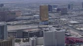 gündüz : Aerial view from above looking at buildings, mountains and streets of Las Vegas, Nevada, USA Stok Video