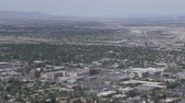 gamble : Aerial view from above looking at buildings, mountains and streets of Las Vegas, Nevada, USA Stock Footage