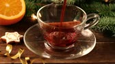 star anise : Mulled wine with spices pouring into glass cup Stock Footage