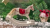 koń : Christmas white rocking horse with falling snow