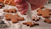 dough : Making and glazing christmas cookies with cookie cutters Stock Footage