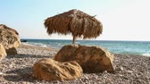 приморский : Sea beach with awning of palm leaves Стоковые видеозаписи