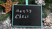 hvězda : Writing Christmas greetings on black chalkboard Dostupné videozáznamy