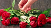 Валентин : Valentines days arrangements with red roses and heart over gray background