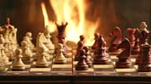 jogos : Chess game by fireplace