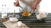 foods : Woman mixes ingredients for sponge cake. Rustic style. Stock Footage