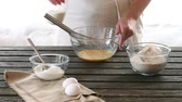 farinha : Woman mixes ingredients for sponge cake. Rustic style. Stock Footage