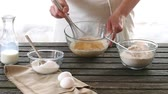 dough : Woman mixes ingredients for sponge cake. Rustic style. Stock Footage