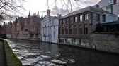romantizm : Cityscape with old bridge and typical Flemish houses. Bruges, Belgium. Stok Video