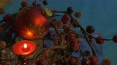 ягода : Red Christmas candle with ornament and red berries