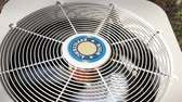 техника : high efficiency heat pump fan spinning providing cool house on a hot day