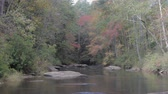 Chauga river in the South Carolina mountains on a windy autumn day Stock Footage