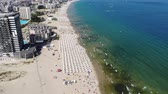 cais : 4K Aerial footage of the beautiful coastline of Bulgaria at the area of Sunny Beach, taken with a drone.