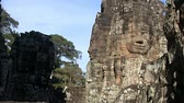 Zoom in on Bayon temple statue  in Angkor Cambodia