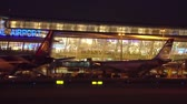 lined up : Slowly Sliding Night View of New Terminal of Phuket International Airport. Thailand.