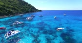 Racha Island Beach. Thailand, Phuket. Yachts , Catamarans and Boats sailing in crrystal clear blue water of ocean. Flying from beach to ocean. Aerial view. 4K.