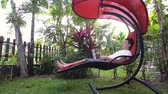 Dream work. Man works in the tropical place, lay on hammock and enjoys his life. The happiest work. Freelance. Slow motion