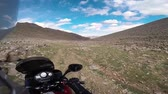 estepe : motorcyclist driving on road in mountains with rocks