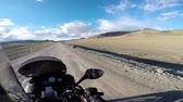 estepe : motorcyclist driving on road in mountains
