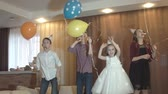 kaka : Children have fun celebrating a birthday. A group of kids jumping, dancing and smiling at a childrens party. Slow motion Stockfilm