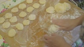 mother board : Making dough pieces with womans hands at home. Stock Footage