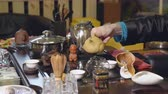 utensil : Chinese traditions. Master pours tea from a glass teapot.