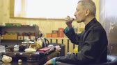 vaidade : Tea ceremony. Master man drinking tea from a white mug.