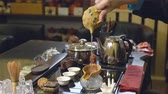 utensil : Master pours tea leaves with water. Tea ceremony.