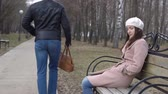 kabelka : Robber carries the womans bag off the bench in the park, slow motion