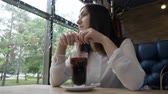 spiced : Young woman in a cafe drinking mulled wine.