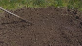 грабли : Season of garden works. Preparation of soil for sowing.