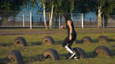 maraton : Fitness young girl doing cross fit exercise on stadium, slow motion Wideo