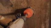 çekiç : Crop view of man drilling wall with hammer drill and core bit making hole in concrete