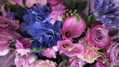 lilás : Flower composition in purple colours with blue hydrangeas, pink roses, lilac Calla lilies and lavender. Creative modern bouquet in floristry studio for sale. Floral business concept. Vídeos