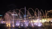 Istanbul, Turkey, 28-05-2019: Modern big amazing fountain with water, light and fire illumination. Jets are illuminated with colorful rays at night and flame flies up above the water. Editorial video.