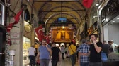 ISTANBULTURKEY - JULY 30 2019: Tourists walk along passage between different souvenir shops and stores in traditional Istanbul shopping mall on July 30 in Istanbul Stock mozgókép