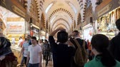 ISTANBULTURKEY - JULY 30 2019: Crowd of happy tourists walks between different shops and stores in traditional Turkish covered market in Istanbul on July 30 in Istanbul Stock mozgókép