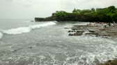 tanah lot : Sunset on the bank of the Indian Ocean, Bali, Indonesia  Stock Footage