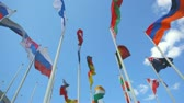 атрибут : Flags of the different countries against the blue sky