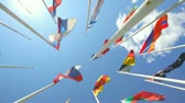 атрибут : Flags of the different countries on a background of the blue sky