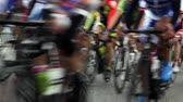 concorrentes : Group of cyclists in action during a cycling tour Stock Footage