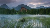 дом : Time lapse clip. Mountain lake in National Park High Tatra. Strbske pleso, Slovakia, Europe. HD video (High Definition)