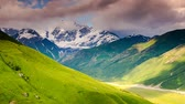 снег : Time lapse clip. Majestic sunset at the foot of  Mt. Shkhara. Dramatic sky. Upper Svaneti, Georgia, Europe. Caucasus mountains. Beauty world. HD video (High Definition)