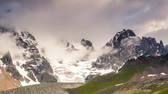 nevoeiro : Time lapse clip. Alpine meadows with dramatic sky at the foot of  Mt. Ushba. Upper Svaneti, Georgia, Europe. Caucasus mountains. Beauty world. HD video (High Definition) Vídeos